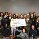 Students of Project LEAH pose with the oversize Project Innovation grant check.